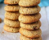 Healthy millet cookies free from preservatives stacked over in two columns, crunchy and healthy biscuits