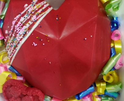 Red heart shape PINATA cake beautifully decorated
