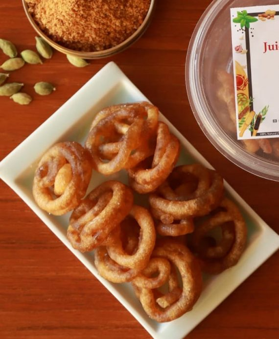 Jaggery jangiri displayed in white plate